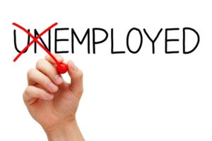 "The word unemployed. The ""Un"" is crossed out making the word ""employed."""
